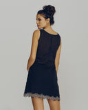 The short hemline and easy cut are reminiscent of 1960's styling