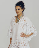 White cotton kaftan from Dana Pisarra showcases painstaking hand-embroidered detailing