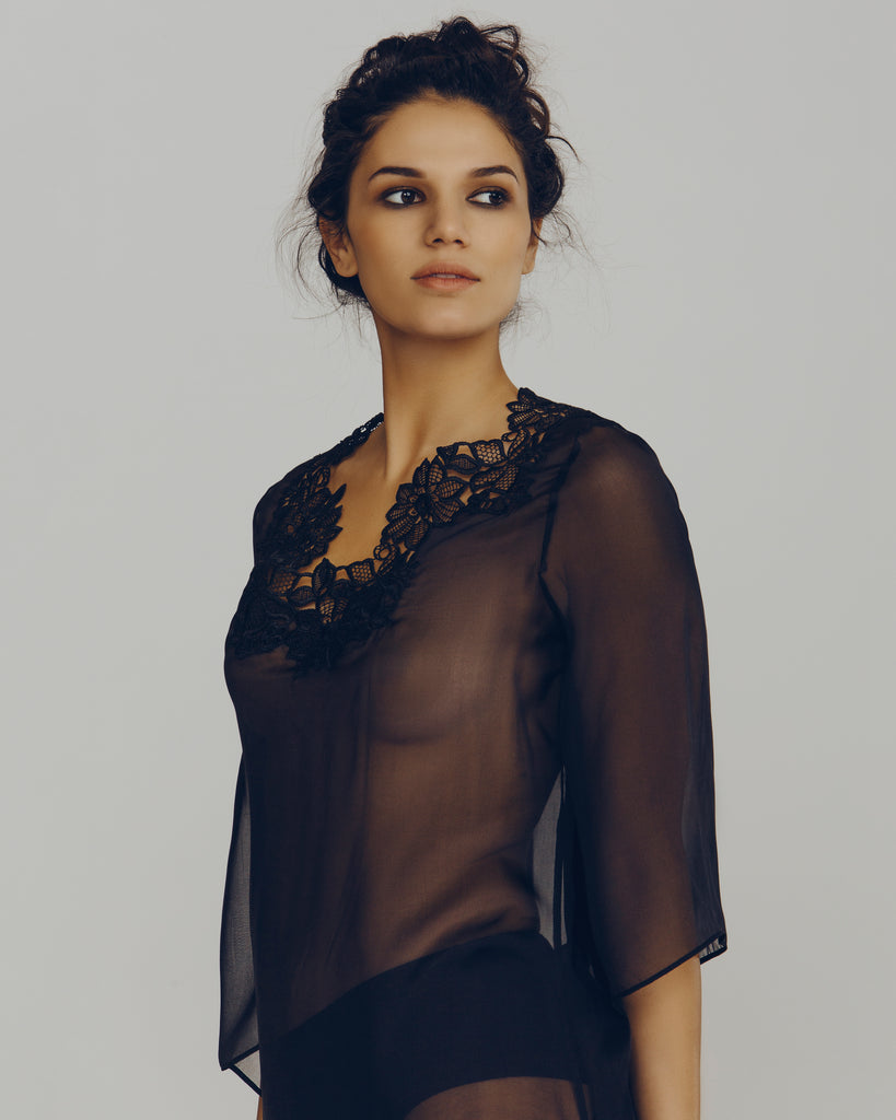 3/4 length bell sleeves with lace accenting at the v neckline