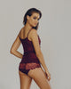 Matching lace boyshort is sheer, mid-rise, and infinitely flattering, with a rib silk gusset from Dana Pisarra
