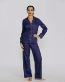 Traditional cotton pajamas from Derek Rose are made from an opulent navy blue cotton with tone-on-tone sateen patterning