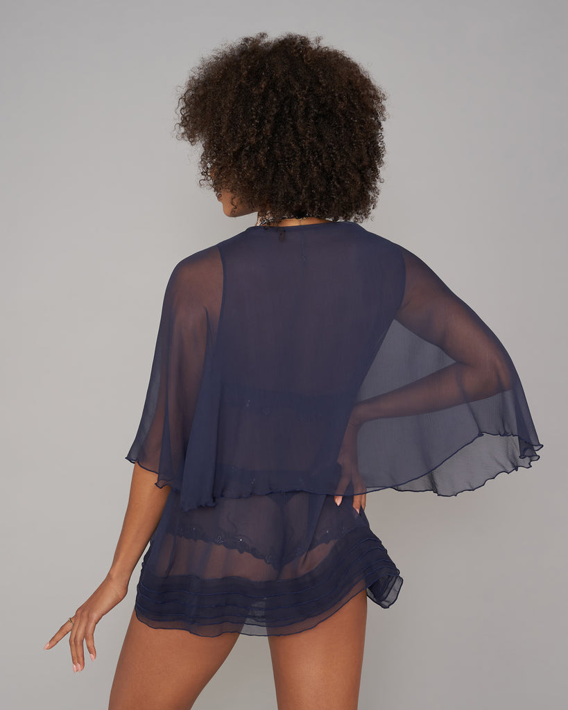 Elise Anderegg's Frou-frou bed jacket has a double layered design has stitching details at the bottom of the lower level