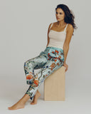 Classic unlined silk trouser showcases a tropical wallpaper pattern in hues of teal, green, coral and blue