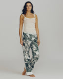 Full-length pants are finished with a wide ivory band at the hem, chic and easy to tailor