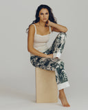 Ivory silk trouser is patterned with a tropical toile print in hunter green