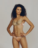 Gilda & Pearl bra and panty set are constructed of pale pink silk and gold lace