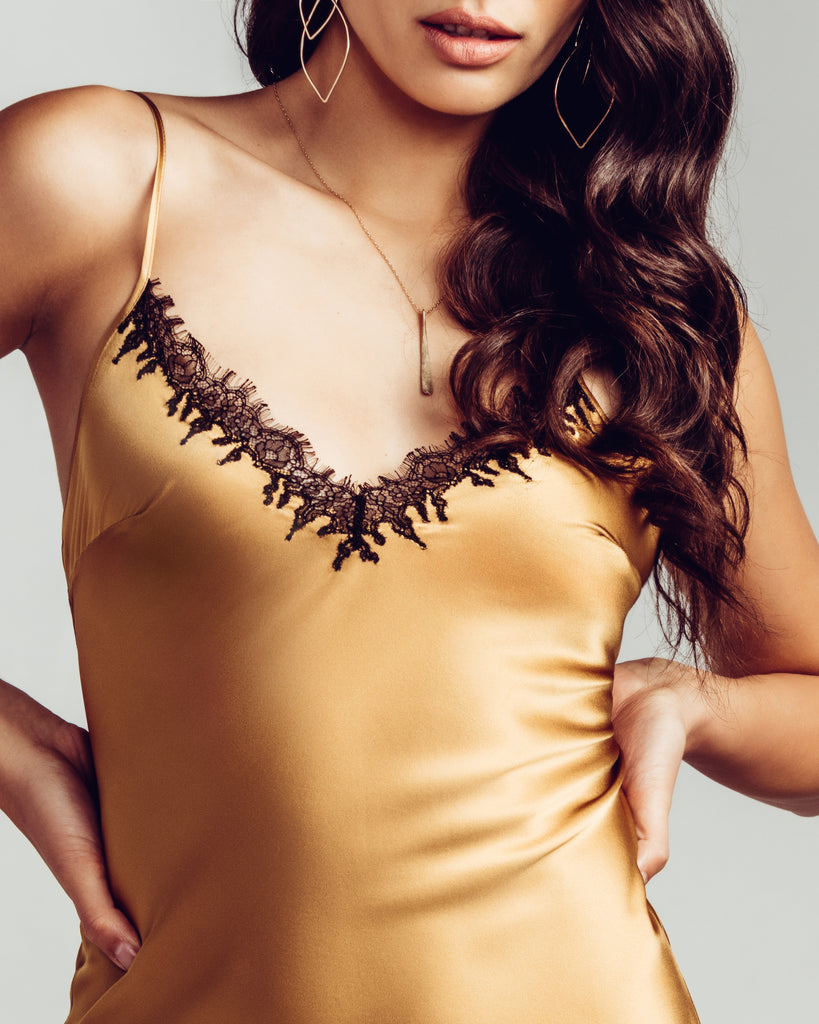 Classic Midnight Cognac silk chemise is crafted from butter-soft antique gold silk with black French Leavers lace trim