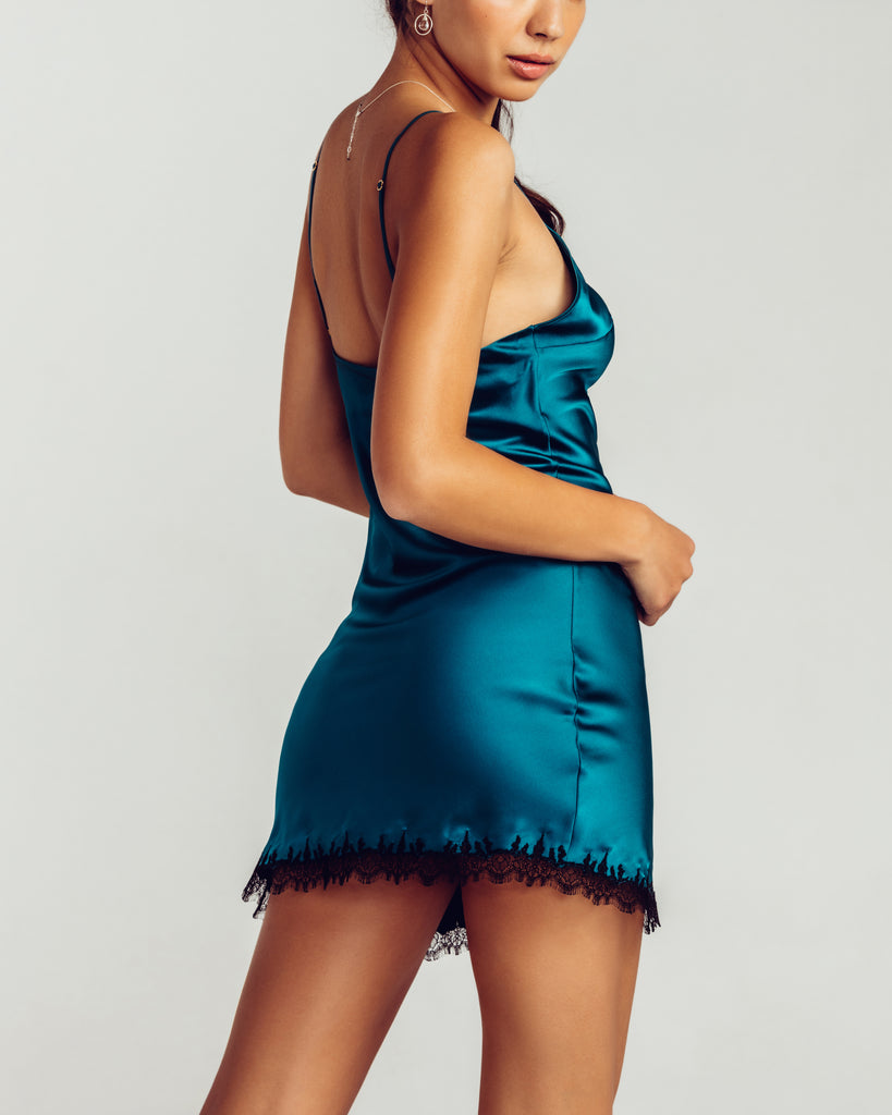 Classic silk chemise from Gilda & Pearl is crafted from butter-soft teal silk with black French Leavers lace trim