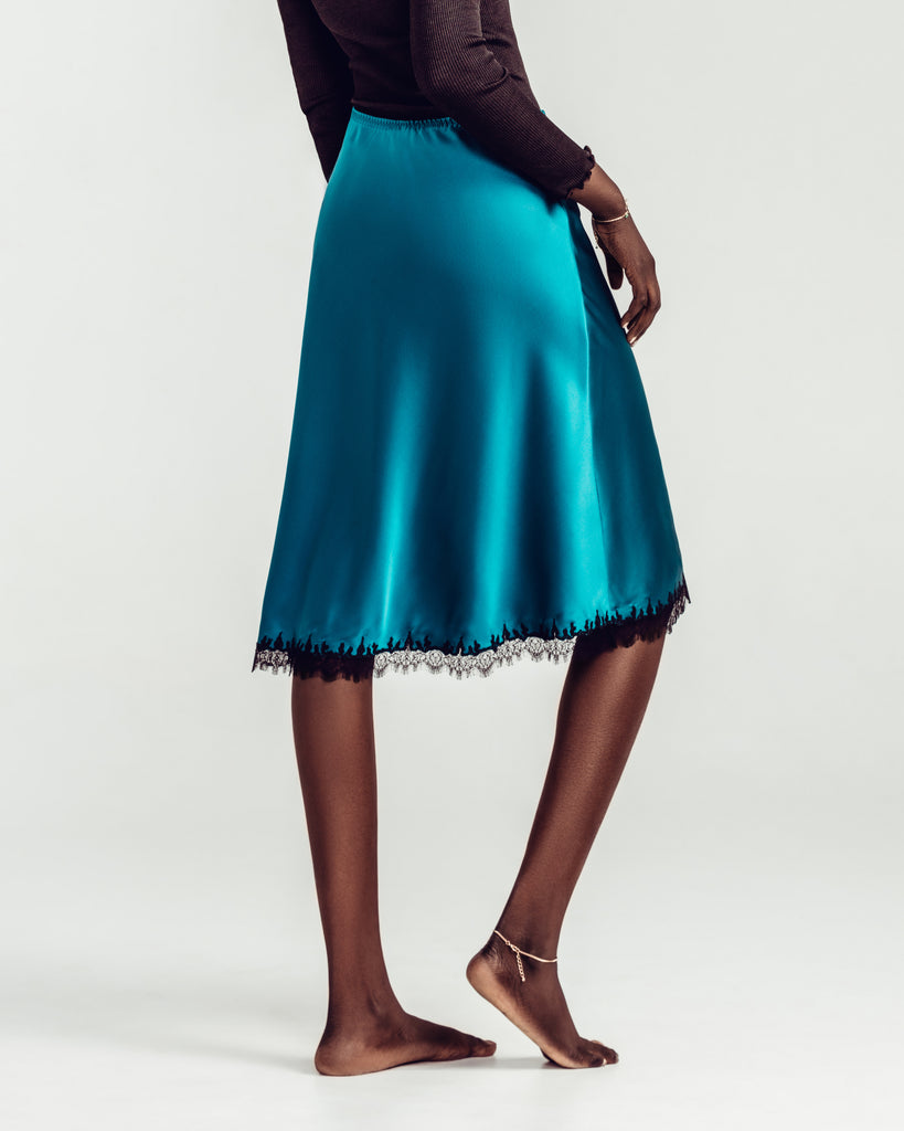 Gilda & Pearl's Midnight Jade slip skirt is bias cut throughout with an elasticized waist