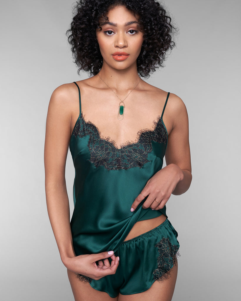 Sleek Ophelia camisole from Gilda & Pearl has adjustable spaghetti straps and a lace-accented v neckline