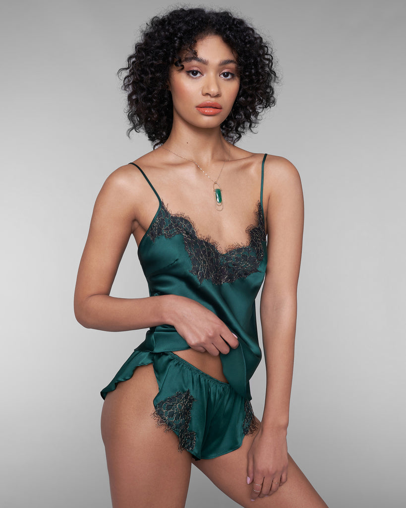 Gilda & Pearl's Ophelia camisole and tap pant set is crafted from emerald green silk accented with delicate black and gold French eyelash lace