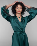 Gilda & Pearl's Ophelia emerald green silk robe hits at the upper thigh on most with long sleeves and an exterior belt tie