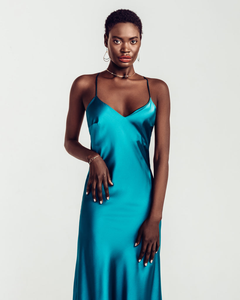 Midi-length Sophia teal silk slipdress from Gilda & Pearl has a chic a-line cut