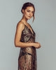 Sheer black and gold lace gown from Gilda & Pearl has scalloped eyelash detailing at the bust and hem