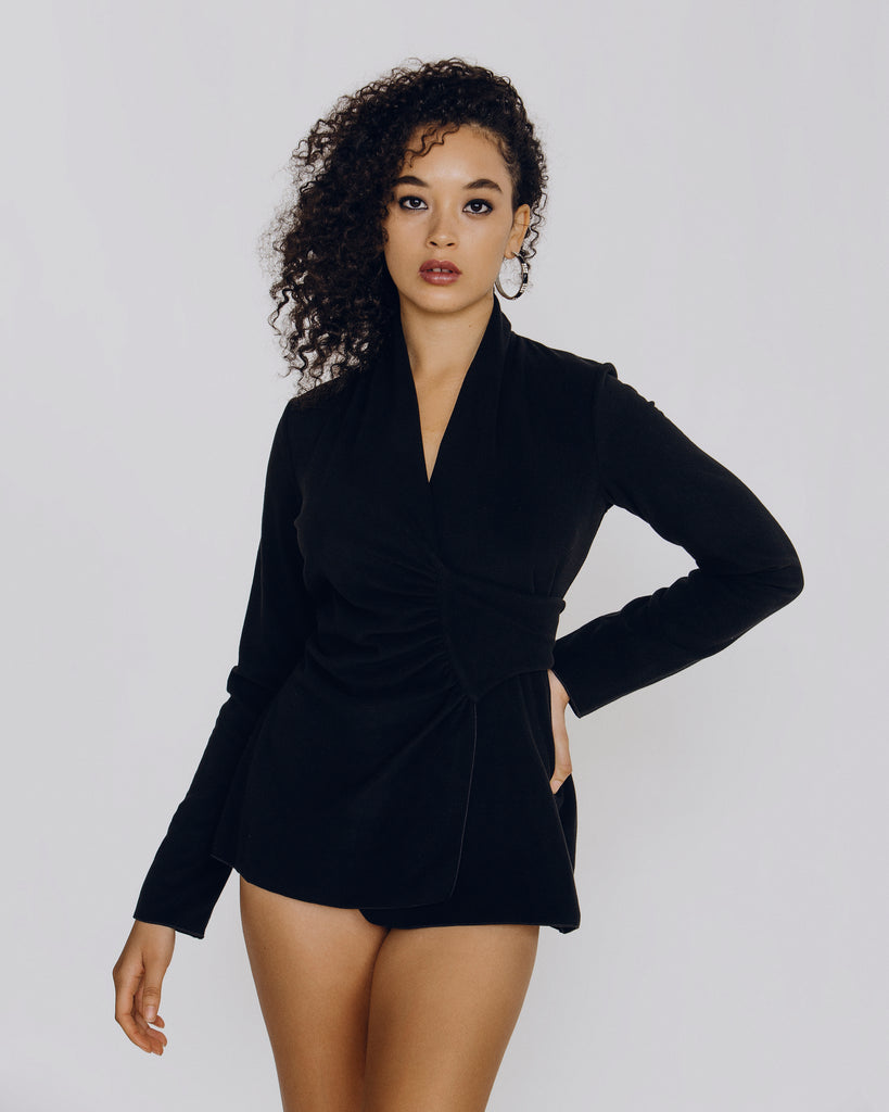 Grazia'lliani long-sleeved wrap style hits at the upper hip