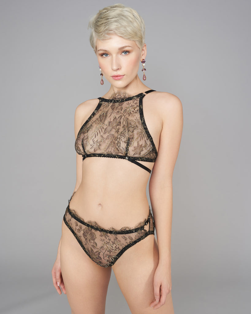 Sheer Antheia lingerie set from Karolina Laskowska is crafted from a black and gold floral lace with scalloped eyelash detailing