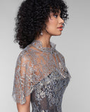 Sheer lace Asteria cape from Karolina Laskowska is crafted entirely of a sheer gold Solstiss lace with pale blue accents