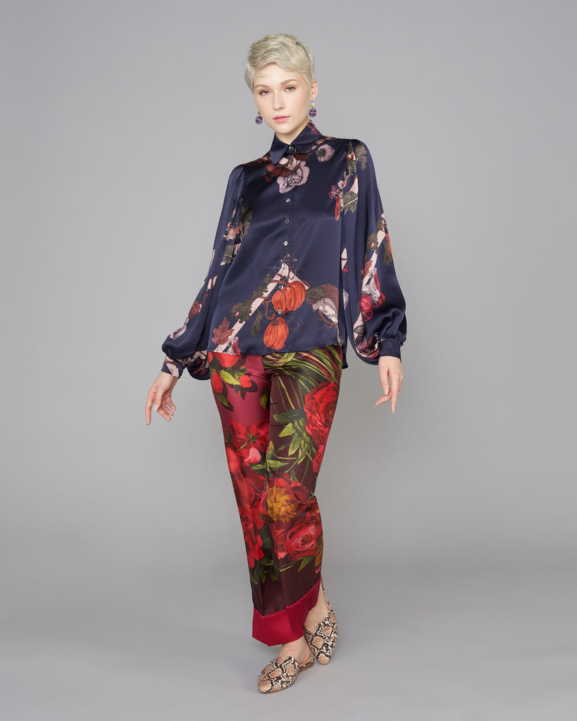 Midnight blue Kew silk blouse from Klements has a hand-drawn woodland pattern in shades of orange, red, purple, brown, and green