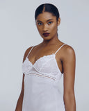 Affinite Couture White cotton slip is accented with Calais lace detailing at the bust and hem