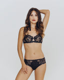 Demi bra features transparent tulle cups embroidered with shimmering floral motifs from Lise Charmel