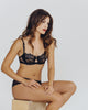 Adjustable straps, multi-hook band, and rigid tulle sling in the cups for fit and support from Lise Charmel.