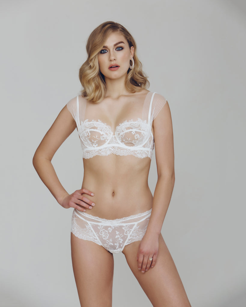 9ac7491751427 ... Longline ivory Demi bra from Lise Charmel has center seaming and tulle  lining for shape with  Matching Art et Volupte boyshort ...
