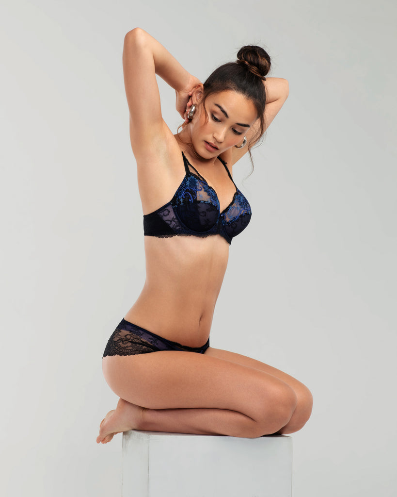 The Fete Precieuse lingerie set from Lise Charmel combines fine Leavers lace, ultra-soft tulle, transparent netting and shimmering embroidery in shades of black and blue