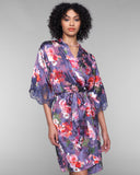 Lise Charmel's Reve Orchidee burnout silk robe hits above the knee on most with an interior and exterior tie for fit