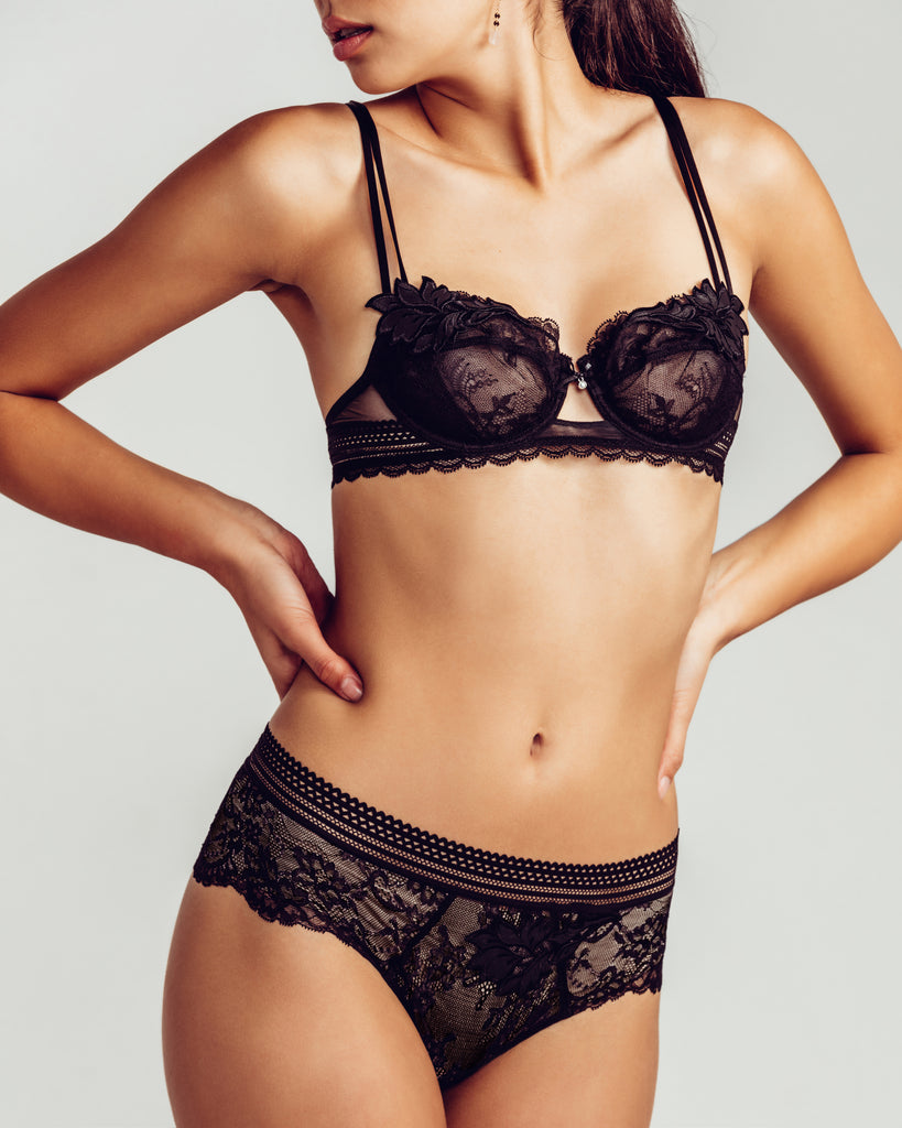 Lise Charmel's Sexy Rebelle lingerie set is crafted from black floral French lace, ultra soft triangle lace, and faux-leather details