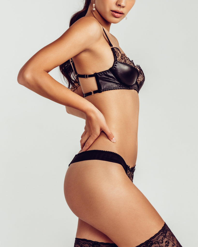 Classic Koressia lingerie set from Loveday London is crafted from black leather, leaver's lace, tulle and silk velvet