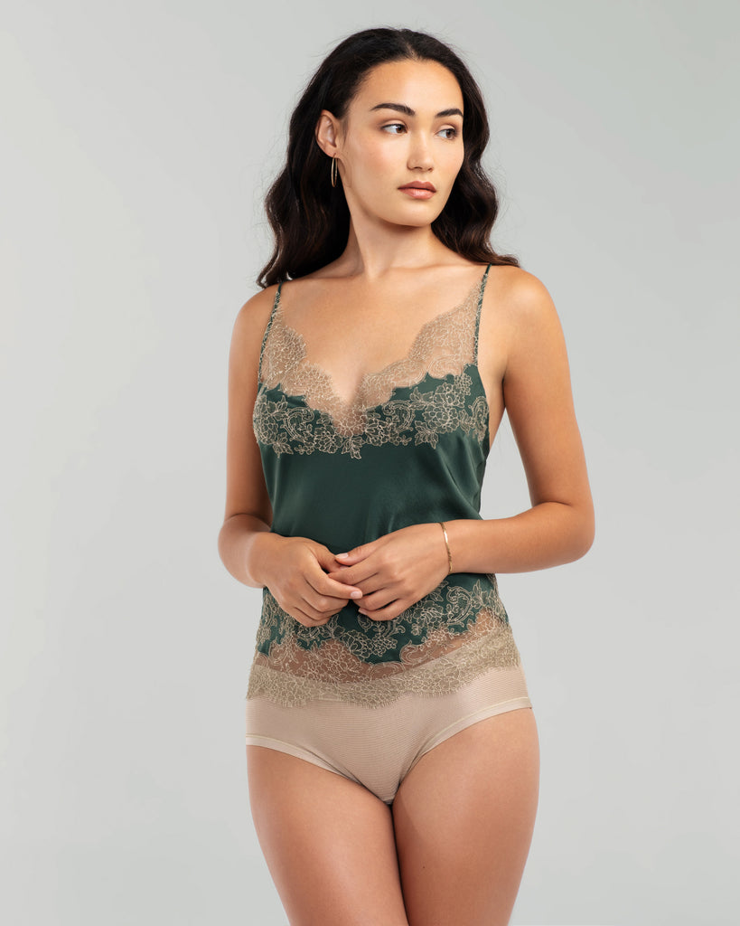 Forest green silk camisole from Merle Noir is accented with swaths of painstakingly appliqué champagne floral lace