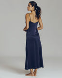 Navy blue gown from Morpho + Luna is constructed of an indulgent sueded silk