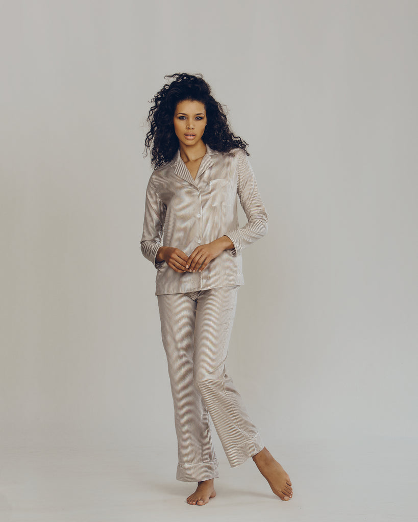 Morpho + Luna ivory silk pajama is accented with metallic gold pinstripes