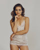 V-neck silk camisole from Morpho + Luna is constructed of ivory silk with shimmering gold stripe detailing