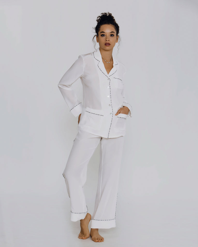 White silk crepe de chine pajama from Olivia Von Halle is lightweight and elegant, with navy patterned piping