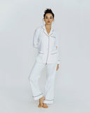 Traditional pajama from Olivia Von Halle is constructed of high-quality heavy weight white cotton & tencel blend