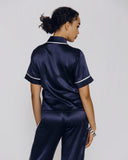 Modern Olivia Von Halle pajama set is constructed of navy blue silk with white flat silk trim