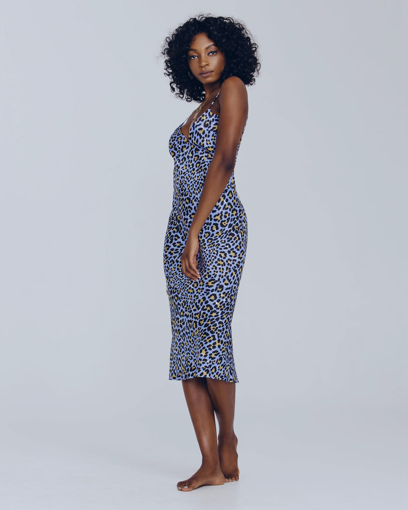 Bias-cut Issa Hedonist silk slip dress in powder blue with a black and gold leopard print