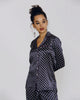 Elegant silk pajama from Olivia Von Halle has a navy background with ivory patterning, reminiscent of mens tie prints.