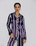 Olivia Von Halle pajama features aubergine purple and ivory vertical stripes -- flattering and dapper, reminiscent of menswear patterning