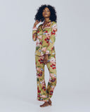 Tailored Lila Havana silk pajama is constructed from gold silk with a tropical floral print in black, white, red, green, pink and powder blue