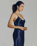 Full-length Olivia Von Halle gown is constructed of a rich, dark blue silk