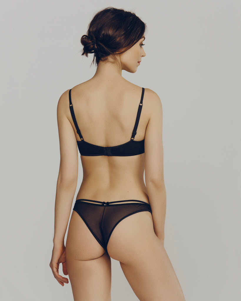 Matching tanga from R Crescentini is sheer and flexible, with textural lace accents at the sides and black silk strap detailing at the rear