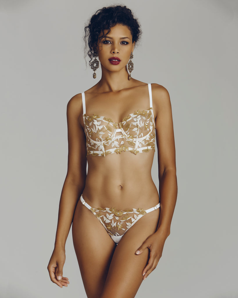 White and gold embroidery embellish sheer white tulle in this lingerie set by Studio Pia