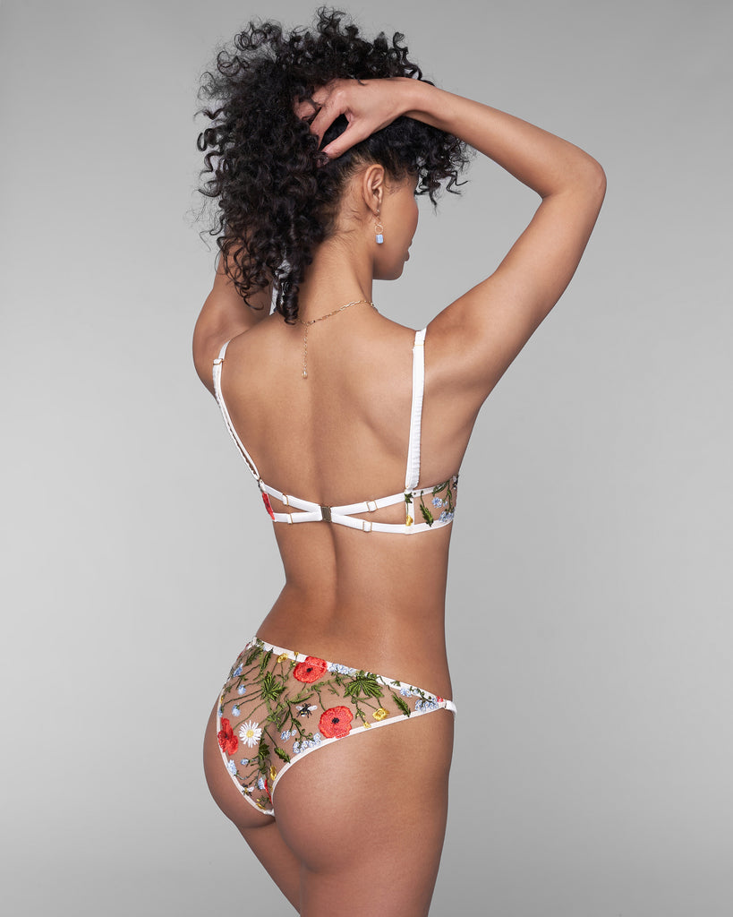 Studio Pia's Flora low-rise bikini panty is entirely crafted of sheer embroidered tulle with a cotton-lined gusset and adjustable padded silk side straps