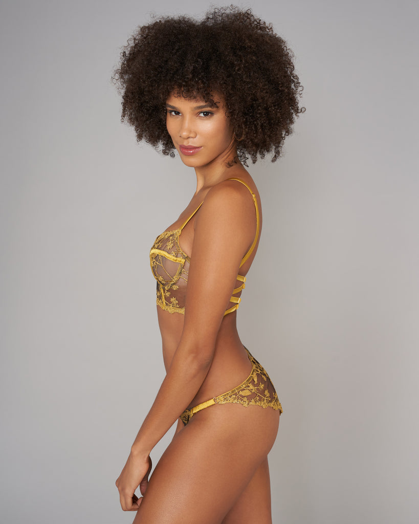 Matching Yuna bikini panty from Studio Pia is sheer in the front and rear with a cotton-lined gusset and padded adjustable side straps