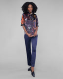 Navy stretch silk trouser from Lise Charmel has a flat waistband with a v seam at the front