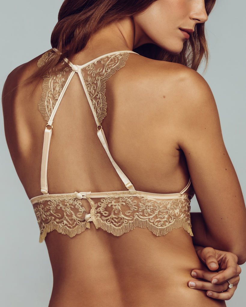 Alhambra bralette has silk straps lead to a unique racerback design, with embroidery details at the upper back and adjustable straps below, closing with two silk covered buttons