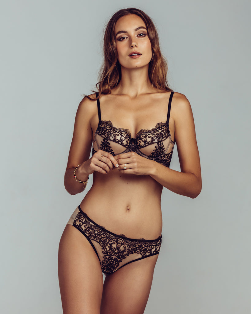 Champagne tulle is accented with dimensional black embroidered appliqué in the Classique Black bra and panty set from Vannina Vesperini