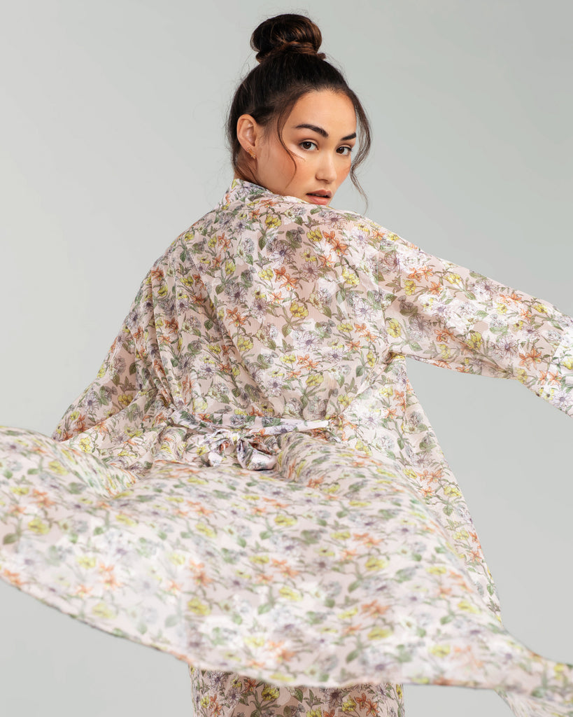 Vannina Vesperini's Vegetal is a classic long-sleeve robe is crafted from a semi-sheer jacquard poly mousseline, patterned with multi-colored flowers and shot through with lurex stripes